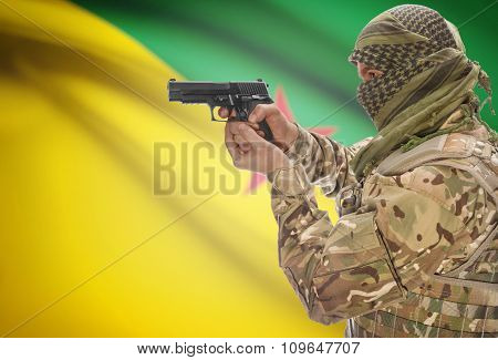 Male With Gun In Hand And National Flag On Background - French Guiana