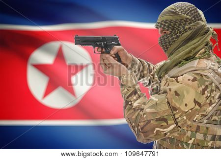 Male With Gun In Hand And National Flag On Background - North Korea