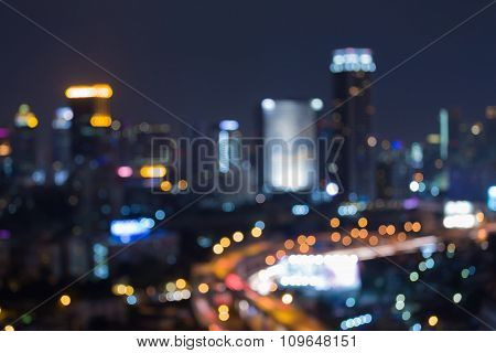 Night blurred bokeh city downtown lights background