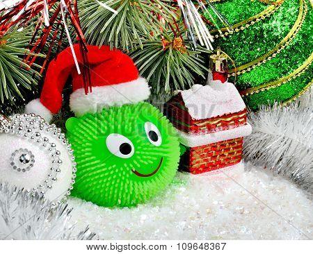 Christmas Snowman With Christmas Balls On Abstract Lights Background.