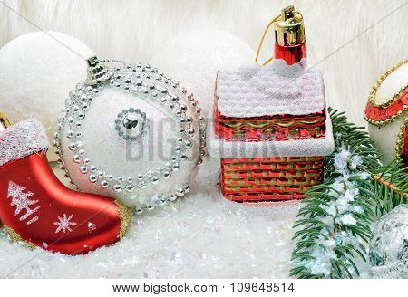 Christmas Background With Snow, Christmas Baubles And Pine Twigs