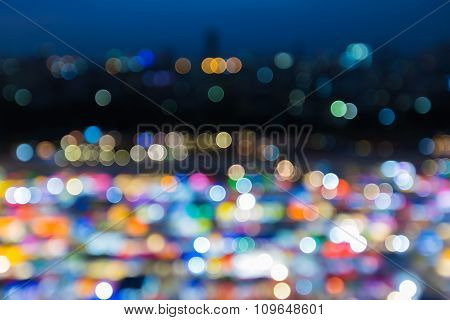 Blurred bokeh city lights background multiple colours at night
