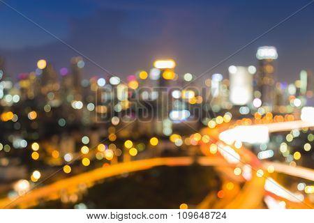Blurred bokeh lights big city highway at night