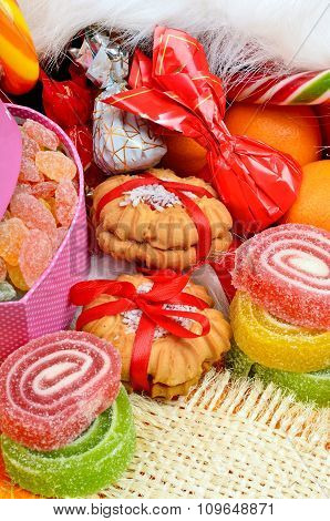 Shortbread Biscuits, Candies, Jellies And Tangerines.