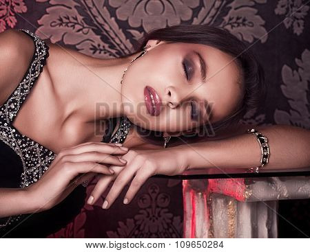 Portrait of beautiful girl with makeup in luxury jewelry