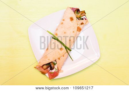 Flatbread with bacon and mushrooms on green top