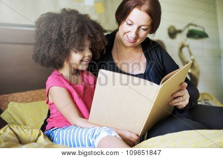 Family Children Daughter Reading Book Bedroom Concept