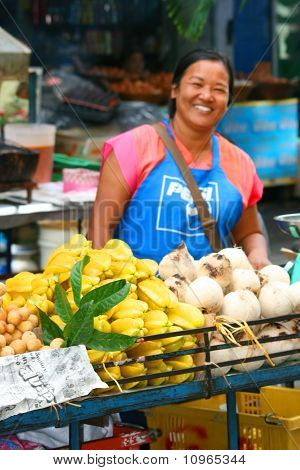 Woman selling food, Thailand.