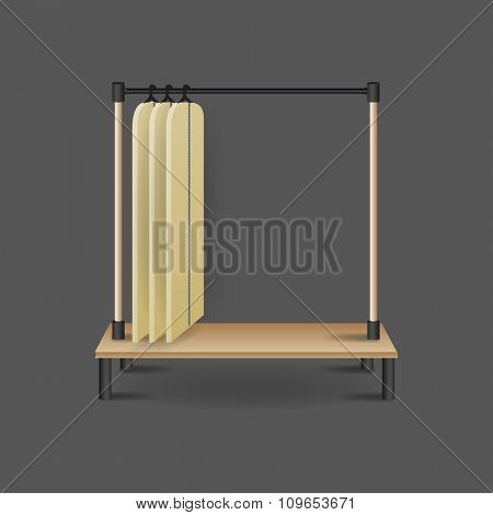 Metal stand with blank shirts hanging, isolated on background.