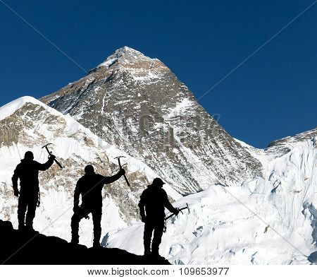 Mount Everest And Silhouette Of Climbing Men