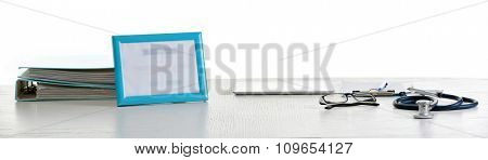 Doctor table with tools on white background