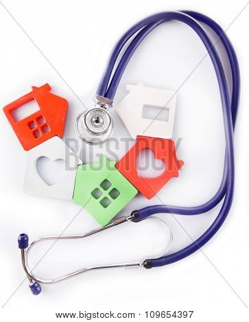 Concept of family medicine - colourful houses and stethoscope isolated on white background
