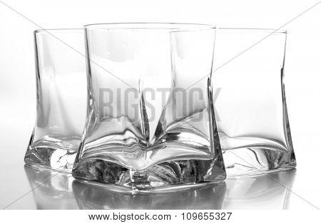 Empty glass jars on white background