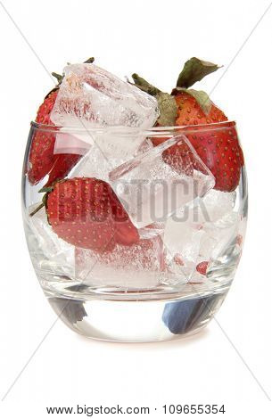 Glass jars with ice and strawberries on a white background