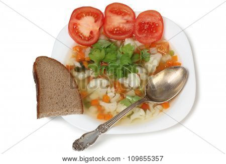 Porcelain plate with vegetable soup on white background