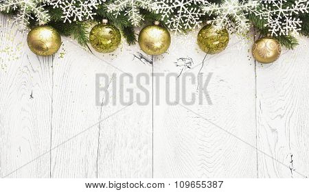 Christmas background with fir branches and green balls