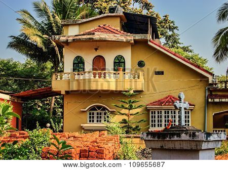 Yellow House With A Balcony And Arched Windows, India.