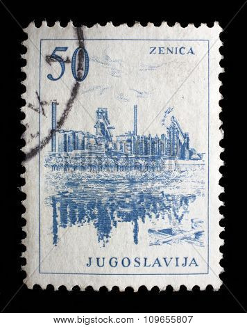 YUGOSLAVIA - CIRCA 1958: Stamp printed in Yugoslavia shows a Iron foundry, Zenica, with the same inscription, from series Industrial Progress circa 1958