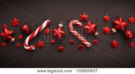 Christmas candy and decorations on dark background
