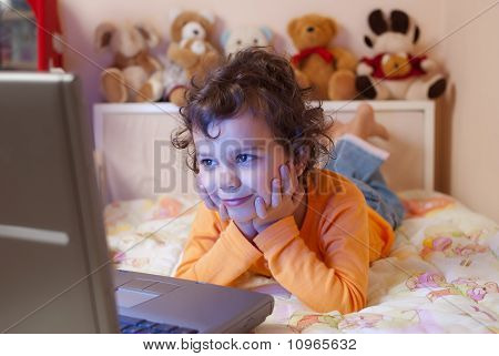 Little Girl In Front Of A Laptop