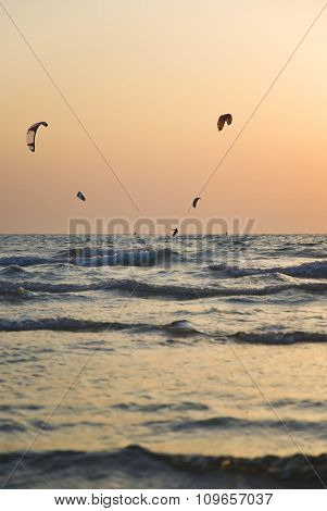 Kite boarding. Kitesurf freestyle at sunset