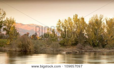 Beautiful autumn landscape. Trees along the banks of a river.