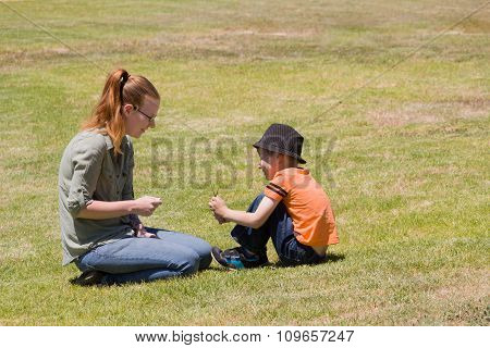Mother And Son Sitting In A Park