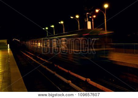 Moving train on the bridge at night