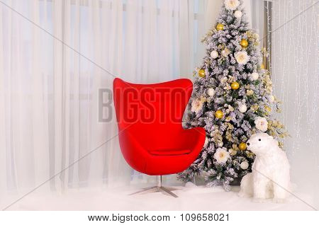 Christmas Tree With Red Armchair And A Polar Bear In The Interior.