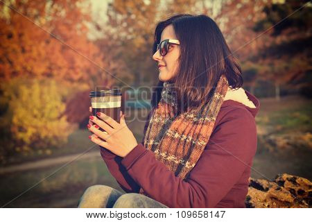 Woman Enjoying Coffee In Park