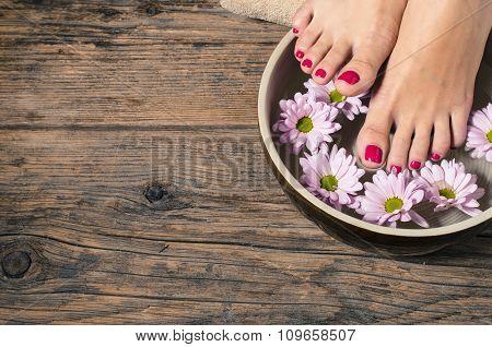 Close up of a female feet in spa salon