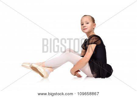 Girl Ballerina Sitting On Floor