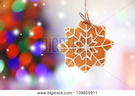 Christmas cookie on shiny abstract background