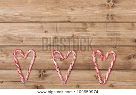 Christmas Background. Candy Canes, Heart Shape. Wooden Table Wit