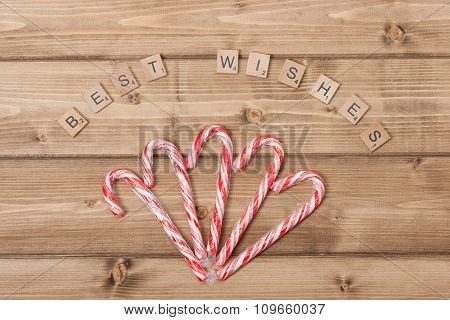 Christmas Background. Candy Canes. Best Wishes Words. Wooden Tab