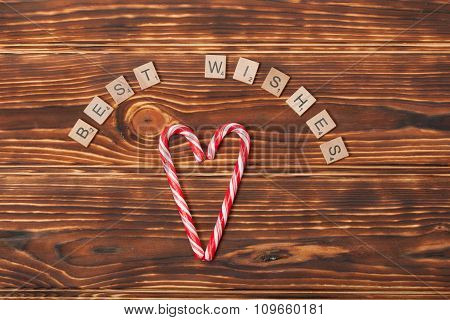 Christmas Background. Candy Canes, Heart Shape. Best Wishes Word