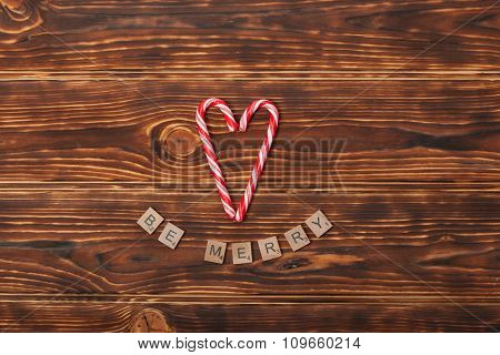 Christmas Background. Candy Canes, Heart Shape. Be Merry Words.