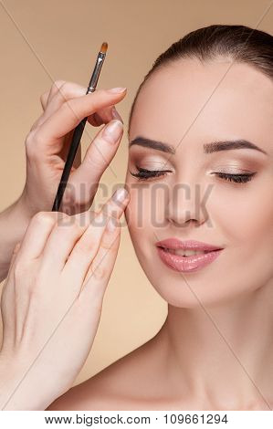 Cheerful female model is visiting beautician at salon