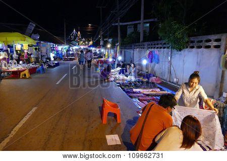 People Walking And Buying Things At Walking Street Night Market