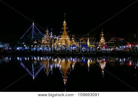 Temple With Reflection On The Pond And Walking Street Night Market