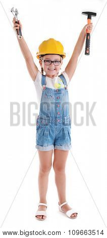 Little girl in yellow helmet with hammer and screw wrench isolated on white background