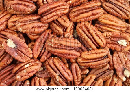 Food background - big shelled pecan nuts situated arbitrarily