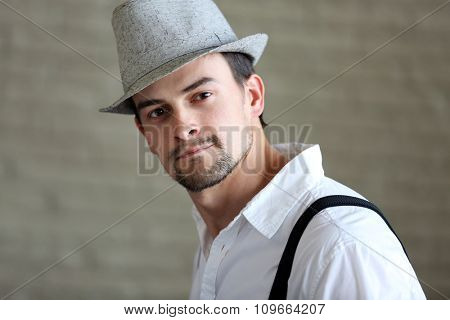 Close up portrait of handsome musician man in hat