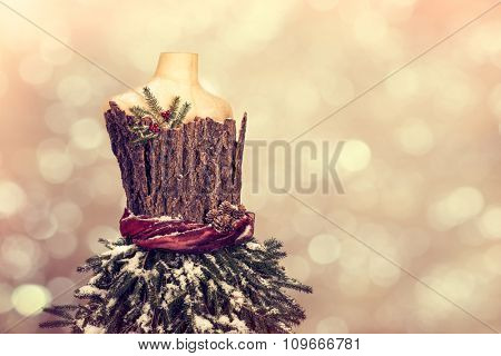 Vintage mannequin decorated with Christmas foliage
