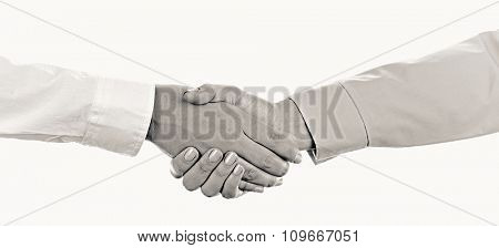 Business handshake, black and white retro stylization