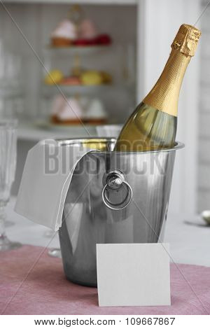 Bottle of champagne on wedding table, close-up