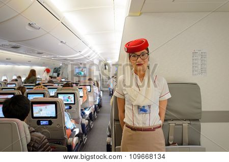 DUBAI - NOVEMBER 17, 2015: Emirates crew member on board of Airbus A380. Emirates is an airline based in Dubai, United Arab Emirates. It is the largest airline in the Middle East.