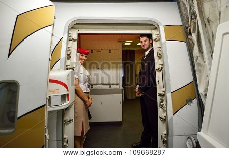 HONG KONG - NOVEMBER 16, 2015: Emirates crew members on board of Boeing 777. Emirates is an airline based in Dubai, United Arab Emirates. It is the largest airline in the Middle East.