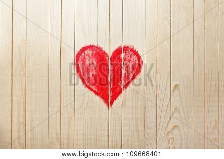 Heart painted on wooden wall