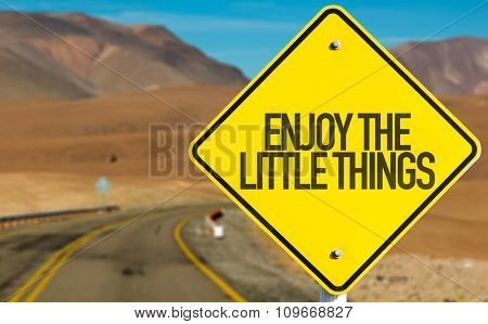 Enjoy the Little Things sign on desert road